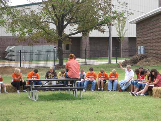 Students at Harrisburg Middle School study in their outdoor class room, which is a part of their new school garden area.