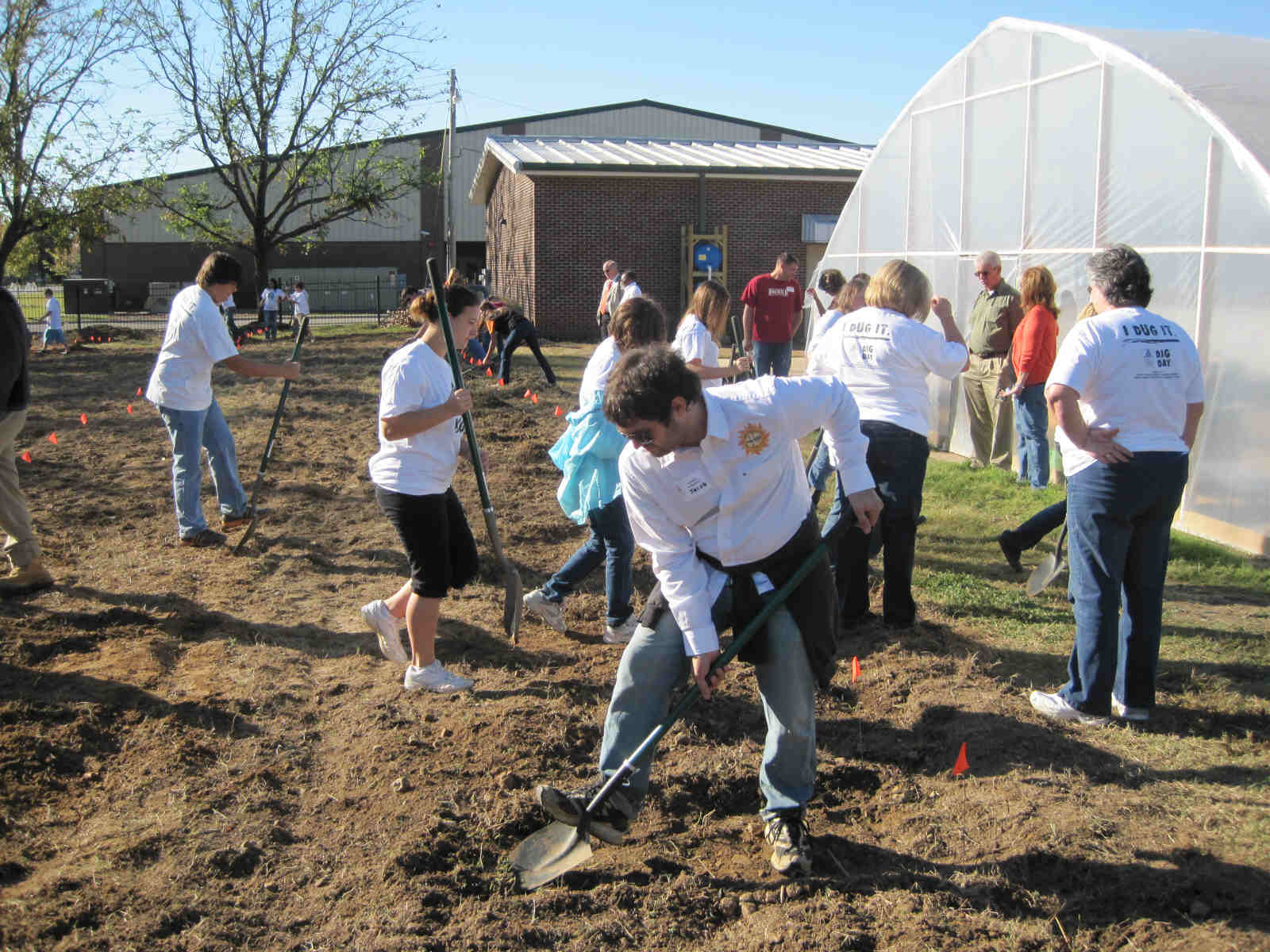 Jacob Holloway a member of MAREH helps students establish their sustainable garden plots at Harrisburg Middle School.