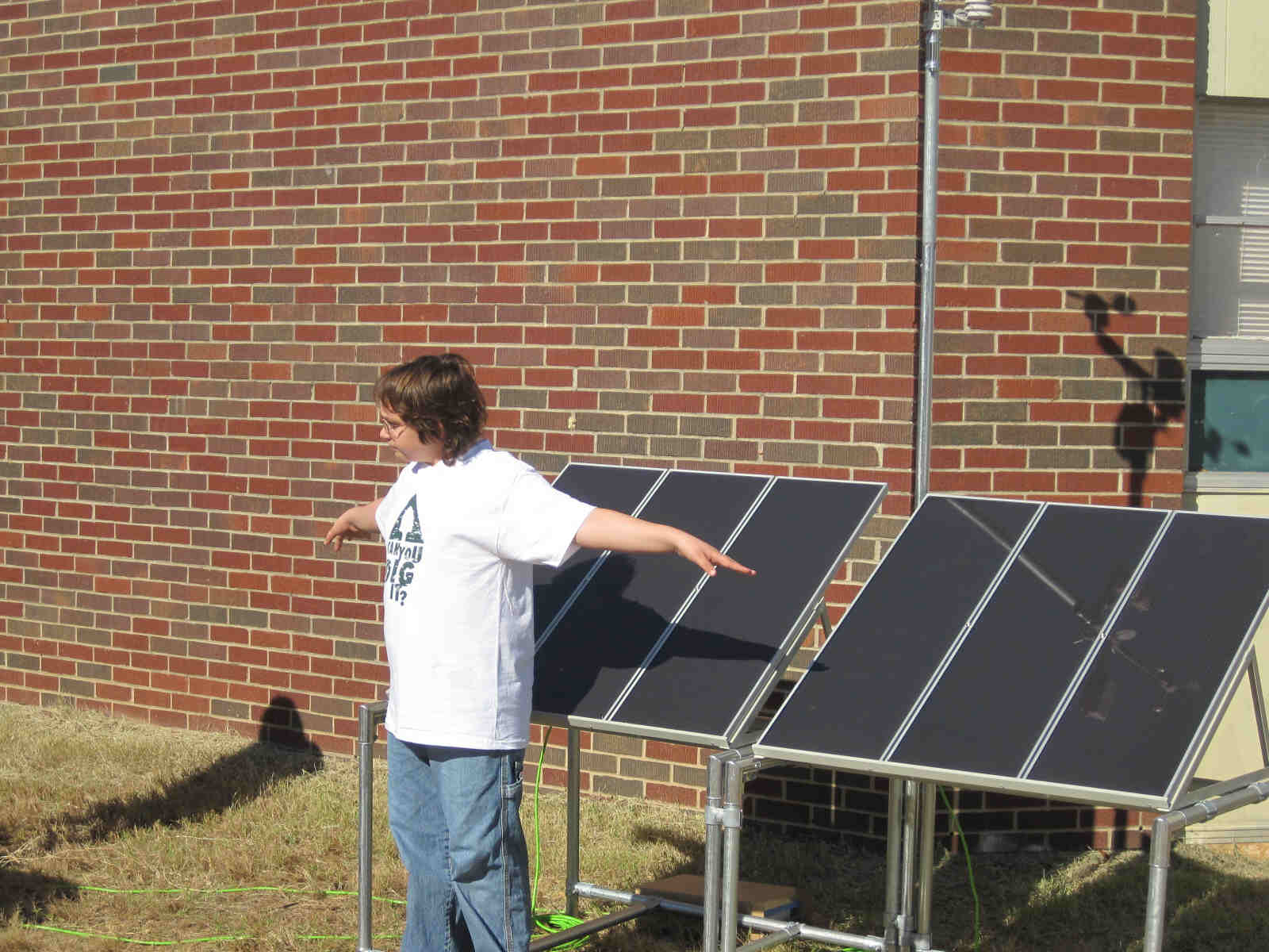 Let the experiments begin.  A student demonstrates the variation of energy production of the solar panels is directly related to the amount of sunlight that strikes them.